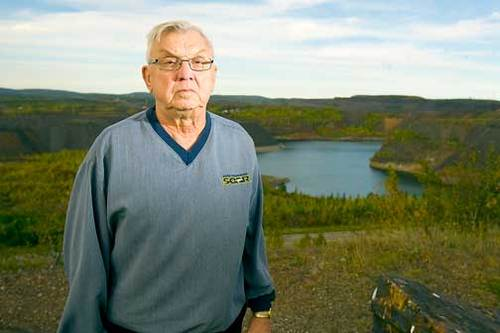 Dave Trach of Leonidas, Minn., is a former mine employee who has lung disease. He is pictured standing on the Leonidas Overlook near Eveleth.